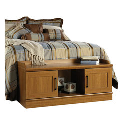 Sauder - Sauder Homeplus Bench in Sienna Oak Finish - Sauder - Bedroom Benches - 413320 - About The Sauder HomePlus Collection:  Add function throughout your home with Sauder HomePlus Storage. This multi-purpose multi-function storage system provides the right amount of style to fit any room - and delivers the function to match. Each piece works as a stand alone or in combination with other pieces to provide a built-in look. Feature-packed with functional extras – like double-deep storage doors movable shelving tilt-out receptacle bins and reversible storage cubbies and doors. Easy to access areas at right-sized depths provide convenient storage for anything that needs put away. Available finished in a warm contemporary Sienna Oak or espresso inspired Dakota Oak with framed doors and detailed base.    Features:
