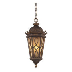 Sterling Industries - 3 Light Outdoor Pendant In Hazlenut Bronze - Located On The Eastern Shore Of Lake Champlain Between The Adirondack And Green Mountains, Burlington Is Charming And Idyllic.  This Series Was Inspired By This Quaint City By The Lake That Prides Itself In The Arts.  The Fine Craftsmanship Of This Collection Is Evident In The Cast Aluminum Details And Scrollwork.  This Series Is Available With Two Glass Options; A Clear Seeded Glass Or Amber Scavo Glass. 3 Light Outdoor Pendant In Hazlenut Bronze And  Amber Scavo Glass