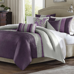 """Madison Park - Amherst Comforter Set - The Amherst bed set is where casual meets contemporary. Amherst is a perfect way to add a splash of color and to give your bedroom a fresh update. The clean color lines of this set make it simple in a way that you can accessorize any way you want. Sleek piping of the fabric on the comforter and pillows gives a strong visual dimension and ties the whole bed together. In addition, there is a floral pillow that adds a softness which is different from the manipulation of fabric and colors on the rest of the set. Features: -Set includes 1 comforter, 2 shams, bedskirt, and 3 decorative pillows. -Pieced polyester dupioni. -Pieced and embroidered decorative pillows. -Polyester jacquard. -Brushed polyester back, pleated comforter and shams. -Dimensions: 90""""-104"""" Height x 90""""-92"""" Width."""
