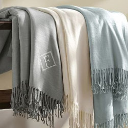 """Monogrammable Blanket Throw, Ivory - Give someone you love a warm blanket to snuggle under. Trimmed with a soft fringe, our throw is an especially great gift idea when accented with a special monogram. 75 x 92"""" Made with soft acrylic yarn. Yarn dyed for vibrant, lasting color. Machine wash. Imported. Monogramming is available at an additional charge. Monogram is 3"""" and will be placed at one corner of the throw."""