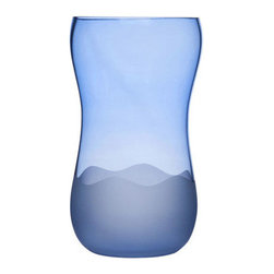 Rolling Waves Glass Vase - The Rolling Waves Glass Vase is artfully modern. Place your favorite flowers in one to greet guests in your foyer, or set one anywhere that could use a delightful splash of color. This timeless mouth-blown vase will be a delight every day.
