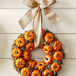 Pumpkin Patch Wreath - Greet your guests with this mini pumpkin wreath. I think it would look great on your front door or hanging from a mirror above the fireplace.