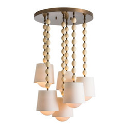 Arteriors - Marfil Cluster Pendant - If any light fixture can help your room move into the realm of the divine, this one might be it. The prayer bead–like chains hold six linen and glass shades at random heights in a choir-like procession. It's a dazzling display that is simply heavenly.