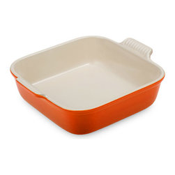 Le Creuset - Le Creuset Heritage Stoneware 8-inch Square Baking Dish - This square dish, with its deep shape that accommodates layered dishes and desserts, is a versatile addition to any kitchen collection. Its solid construction and durable finish stand up to years of use, and the scalloped handles are a stylish reminder of Le Creusets long history of classic designs.