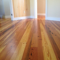 Reclaimed Heart Pine Flooring-Yarmouth Maine - The reclaimed antique heart pine was installed on a diagonal and took advantage of the unusually long lengths supplied by Barnstormers Reclaimed wood flooring.