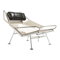 Stilnovo Corded Flag Chair - The Flag chair is a tubular steel frame rigged with yards upon yards of ship cordage. The base frame is a white powder coated steel tubing while the upper part is polished steel. Included is a full aniline black leather pillow. The lounging chair has a wide open surface with arms that can hold your book and glasses while you drift off to sleep.