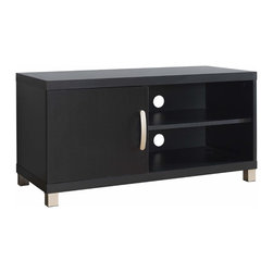 "Techni Mobili - Techni Mobili 40 Inch TV Stand w/ 1 Door in Black - 40 Inch TV Stand w/ 1 Door in Black by Techni Mobli This contemporary Techni Mobili TV cabinet , for TVs up to 40"", is designed to fit any bedroom or family room. It includes one cabinet and additional shelf for optimal storage. The Techni Mobili TV cabinet is made of heavy duty compressed wood and laminate surface that is resistant to scratches.  TV stand features addtional storage space for your electronics and gaming accessories.   Techni Mobili TV Cabinet: Contemporary styling 1 cabinet for accessory storage, audio or gaming components Additional storage space Made of compressed wood with laminate surface Black finish Fits flat screen TVs up to 37"" (maximum weight: 90 lbs) 1-year limited warranty Assembly required Dimensions: 36""L x 15.5""W x 15.75""H  TV Stand (1)"