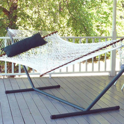 Pawleys Island Hammocks - Island Bay XL Rope Hammock with Optional 15 ft. Steel Hammock Stand Multicolor - - Shop for Hammocks from Hayneedle.com! If you want to enjoy the relaxed leisurely ambience of a tropical resort in the comfort of your own backyard the Island Bay XL Rope Hammock with Optional 15 ft. Steel Hammock Stand is the perfect choice for you! Made of extra-soft thick 8mm twisted rope cord this hammock cradles your body with the perfect amount of support and comfort needed for total relaxation. The 8mm rope cord is the thickest and most durable you'll find in the hammock industry which means you are assured of years of enjoyment. This rope hammock is available in your choice of cotton which is extremely soft or polyester which will better withstand the elements.Weather-treated oak spreader bars hold the hammock open for easy getting in and out. It has a weight capacity of 450 pounds and the dimensions of the bed itself are 6 feet 10 inches in length and 5 feet in width. Powder-coated for weather- and rust-resistance the optional heavy-duty 14-gauge steel stand is built to last. Zinc-plated hanging hardware is included with this hammock so you can hang your hammock and relax in no time. If you're in the mood to relax like never before this summer and for many summers to come you'll not go wrong with this rope hammock!Additional features:Bed width: 5 ft.; bed length: 6 ft. 10 in.Stand dimensions: 13 - 15 ft. L x 4 ft. W x 3 ft. 9 in. H in.Made with 975 feet of twisted rope8mm cotton cord the thickest and most durable in the industryManufacturer's 1-year warrantyZinc-plated hanging hardware includedPillow not includedAbout Island Bay HammocksIsland Bay Hammocks come to you directly from the skilled hammock artisans of Chennai India. Using the latest technology alongside time-tested traditional methods of construction these hammocks are woven with pride.
