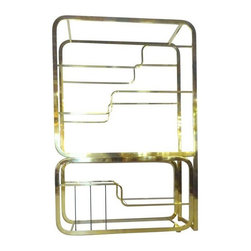 Pre-owned Two-Piece Brass Milo Baughman Etagere - A stunning and fluid 2-piece etagere attributed to Milo Baughman. The shelf is comprised of gold plated steel and 12 glass panes. The bottom piece can be moved 3 different ways: to fit flush underneath the top piece, to extend, and to turn at a 90 degree angle, creating an L shape. Vertical dividers on the lower portion for records, books, or storage.    It is in very good vintage condition. The 3 glass shelves and their shelf pins have been newly replaced. There is light scuffing to the brass finish in isolated areas; does not detract from piece.