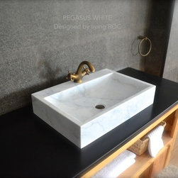 Living'ROC - White Marble Bathroom vessel sink + faucet hole - PEGASUS WHITE - Rectangular Natural stone vessel sink PEGASUS WHITE -  23-2/3' x 15-2/3' x 4-3/4' - genuine interior decoration Guangxi White marble. The 'Exceptional' cut in the block without any comparison with plastic and other chemical resin market often unaffordable.  You will definitely not let anyone feel indifferent with this 100% natural stone unique in the US and exclusively available on Living'ROC.net.  Feel free to click on our facebook portfolio page to inspire yourself with our clients' projects...Simply our living'ROC style.  How to make your bathroom unique! Made from a superb block of Guangxi White  Marble this basin will delight lovers of beautiful work looking for rare products. Add value to your home by transforming your bathroom into an oasis of elegance calm and tranquillity. Discover the well-being and the restful feeling our creation can offer you. PEGASUS WHITE  is one of the most fashionable in our bathrooms range. This vessel sink is not only beautiful to look at it is also functional with its height and its edges allowing a large amount of water. Guangxi marble is dominant in strength of great value and authentic in look and feel.  Our creation is delivered without an overflow drain and faucet (not included) - every US drains and faucets models you can find on the market will fit perfectly on Living'ROC vessel sink. This model is ready to use over the countertop. The photos you see online have been taken with extreme care by our Founder CEO - Florent LEPVREAU because without them we would not be one of the natural stone business key player of the online European continent. Once you have encountered the product in your home you will always have pure happiness for the love of the materials. It will be beyond your expectations because what you see online at livingroc.net is what you will receive. This is why we always guarantee a degree of quality (Grade A) and impeccable finish 