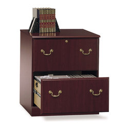 Bush - Executive Lateral File - Saratoga - Very stately in appearance, this lateral file will supply all of the room that you need for your files.  Conveniently, this lateral file holds many different sizes of files including the large legal sizes that are often hard to fit into standard file cabinets.  Not only can you get organized but you can make your office look great with the beautiful cherry finish and polished brass hardware.  Private files or personal items will be safe behind the locked upper drawer in this Lateral File.  Interlocking drawers reduce chance of tipping. * Locking upper drawer for added privacy. Sliding file drawer for letter-. legal- #A4-size files. Interlocking drawers to reduce chances of falling. Harvest Cherry finish. Easy Assembly-phone support available. File Drawer Compartment: 9.49 in. x 23.43 in. x 12.20 in.. 30.47 in. x 26.87 in. x 19.37 in.