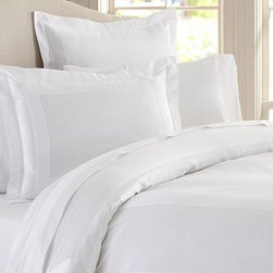 Hotel 600-Thread-Count Duvet Cover, Full/Queen, White - Like bedding found in the finest luxury hotels, our duvet cover and sham are sateen woven to a luxurious 600-thread-count, giving them supersoft texture and a silky luster. Made of 100% cotton sateen. 600-thread count. Duvet and sham reverse to self. Duvet cover has a hidden button closure and interior ties to keep the duvet in place; sham has an envelope closure. Duvet cover, sham and insert sold separately. Machine wash. Made in Italy. Monogramming is available at an additional charge. Monogram will be centered on the duvet cover and the sham.