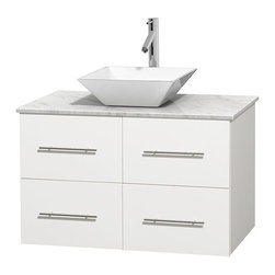 "Wyndham Collection - Centra 36"" Matte White SGL Vanity, Carrera Marble Top, WT Porcelain Sink, No Mrr - Simplicity and elegance combine in the perfect lines of the Centra vanity by the Wyndham Collection. If cutting-edge contemporary design is your style then the Centra vanity is for you - modern, chic and built to last a lifetime. Available with green glass, pure white man-made stone, ivory marble or white carrera marble counters, with stunning vessel or undermount sink(s) and matching Mrr(s). Featuring soft close door hinges, drawer glides, and meticulously finished with brushed chrome hardware. The attention to detail on this beautiful vanity is second to none."
