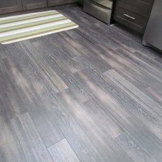 Modern Laminate Flooring by Michelle Yaworski – Gem Cabinets Ltd