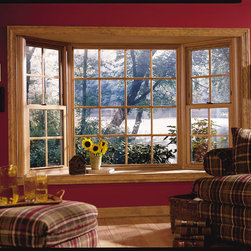 "Bay Window - Bay Window with double hung flankers with light oak interior wood finish and 5/8"" flat grid."