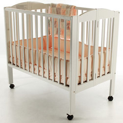 Dream On Me - Portable Folding Convertible Crib - Features: -Made of birchwood.-Dual hooded, locking wheels.-Include stationary (non drop side) rail system.-Easily converts crib to a changing station or playpen in seconds.-This is a NON-Drop Side crib.-1'' Mattress pad included.-Non-toxic finish.-Portable Crib Collection.-Collection: Portable Crib.-Distressed: No.Specifications: -3 Level portable crib available.Dimensions: -40'' H x 26'' W x 41'' D, 32 lbs.-Overall Product Weight: 32 lbs.Warranty: -30 Days manufacturer's warranty.