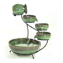 Serenity Health & Home Decor - Outdoor Classics Green Sand Ceramic Cascade Solar Fountain - This fountain will add elegance to your garden without the hassle of an electric fountain. Using solar energy, this fountain pumps water from the bottom basin to top bowl, moving water to each level creating varying sounds of lovely resonance which will fill your garden with serenity.