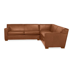 Dean Leather Sectional - Oh, what a sleek sectional — those feet just blend right into the upholstery.