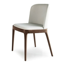 Cattelan Italia - Cattelan Italia   Magda Dining Chair - Made in Italy by Cattelan Italia.The Magna Dining Chair is a subtle exhibition of Italy's legacy of workmanship and design embedded in quality and functionality. Its classic elegance stems from its low profile, minimalist design. Premium soft leather wrapped over generously cushioned seat and slightly rounded backrest lends an element of luxury to the piece. While complementing its classic look, four solid timber legs tastefully keep the seat steady. The chair's slim silhouette makes it ideal for tight spaces and for pairing with coffee, side and dining tables in any traditional setting. The absence of arms gives a sense of openness and enables unrestricted movement. Options for wood finish and leather offered.