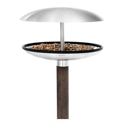 Blomus - Fuera Bird Feeder/Birdbath - The latest dish on bird feeders is this: Birds love the simplicity of a bowl feeder so they can choose their favorite seed. And if it's covered during rain and snow seasons, all the better. The news you'll love? This Fuera bird feeder/bird bath is easy for you to fill and clean. That simple. No angry birds here.