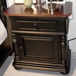 Summit 1-Door 1 Drawer Nightstand - Pepper Black/Jamestown Cherry - Elegance is easy when the Summit 1-Door 1 Drawer Nightstand - Pepper Black/Jamestown Cherry is part of your bedroom decor. The perfect bedside addition, this nightstand is made of poplar solids with cherry veneers that are finished in a two-tone Pepper Black and Jamestown Cherry hue, complete with distressing for a lived-in look. The lower cabinet is flanked by handsome center columns, and the drawer delivers only the best. Its sturdy dovetail joinery, smooth ball bearing glides, and decorative print bottom all combine for an unparalleled design. There's even a two-outlet power bar with a wiring access hole right inside the drawer, so it's easy to charge a cell phone or tablet.Notes on Riverside ConstructionAll Riverside domestic furniture is constructed of fine oak, ash, poplar, and pine wood. These wood types are durable and feature beautiful, open grains that make them much preferred among furniture manufacturers. Each piece of wood is first graded for quality, then kiln-dried to remove excess moisture and prevent splitting. The wood is then constructed into a high-quality furniture piece using a combination of hardwood solids and hand-selected veneers. Techniques used on Riverside pieces include dovetail joinery, heavy-duty drawer roller guides, and multi-step finish applications that include hand-sanding and polishing for a deep, lustrous result. All Riverside furniture is given this high-quality treatment to ensure the beauty and durability of your final product.About Riverside FurnitureRiverside has been growing for more than half a century. The company's founder, Herman Udouj, opened the doors to his first factory in 1946, and along with 12 employees, he began making handcrafted furniture for the post-World War II Baby Boom era. Since then, generations of customers have furnished their homes and offices with Riverside's wide range of furniture products. Riverside strives to be trusted for quality products that are an affordable value. It's just that simple.Care and MaintenanceIt's recommended that Riverside furniture be cleaned with a damp, clean dust cloth. Any kind of surface or finish may be cleaned using this method. A mild detergent may be applied, if necessary, for areas that will not clean with just a cloth. Avoid the use of oil-based polishes and direct-spray polishes that can cause a waxy build-up.Placing hot items, such as coffee mugs or dinner plates on a piece of furniture can soften the finish. Condensation from cold objects or liquid spills will cause the finish to bubble and leave a milky-white discoloration. Never use fingernail polish remover over a wood finish because if it makes contact with the finish it will eat through it much like a paint or varnish remover exposing the wood underneath and demanding that the surface be refinished to repair the damage. The damage described above can be eliminated by the use of coasters, trivets, and common sense.Always use a protective pad beneath lamps or accessories, and on writing surfaces. Do not place rubber or vinyl products on the surface as discoloration and/or staining may occur as a result.