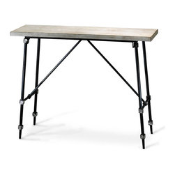 Doris Console Table - Emphasizing its vertical height with sharp angles, elongated feet, and a narrow presence, the Doris Console Table is arrestingly geometric, architecturally simple, and altogether austere against your wall. Cubic joints in the structure of its legs and stretchers are distressed to review the scratched gleam of metal, picking up the lightness of its ivory top.