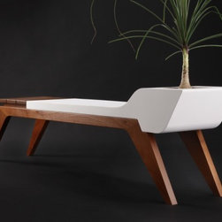 Silent Evolution - Jory Brigham - Inspired by midcentury classic designs, the bench uses a modern concrete and wood combination to be used indoors and out. Multi-functionality and versatility make for an one attractive piece of furniture.