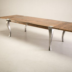 "Jerry Sandeno - My Fence Rail Parsons Table combines reclaimed wood planks off working cattle ranches with my hand-sculpted steel legs formed in a Queen Anne style. The table shown is 82"" X 43"" and has two 24"" extensions to seat up to twelve. Custom sizes are available."