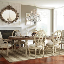 American Drew - Jessica McClintock The Boutique Collection 7 Piece Dining Table Set Multicolor - - Shop for Dining Sets from Hayneedle.com! Create a majestic baroque upgrade for your dining space with the Jessica McClintock The Boutique Collection 7 Piece Dining Table Set. This dining set includes a table two generous leaves and six chairs that are rich in detail. All pieces are made of oak and pecan veneers in a heavily distressed White Veil wash that enhances the details. The table and chairs stand on ornately carved cabriole legs. The four side chairs and two arm chairs all feature intricately carved oval shield backs and cabriole legs. Padded seats are upholstered in neutral linen. The arm chairs have scrolled arms and are a bit roomier. The centerpiece of the set is the massive table with curved stretcher. Its oval top features a Revival finish that adds to the antique appeal. It includes two 24-inch leaves that extend it to a generous 148 inches.Product Dimensions:Table dimensions: 100-148L x 50W x 30H in.Side chair dimensions (ea.): 23.88W x 27D x 44H in.Arm chair dimensions (ea.): 26.5W x 26.5D x 44H in.About American DrewFounded in 1927 American Drew is a well-established leading manufacturer of medium- to upper-medium-priced bedroom dining room and occasional furniture. American Drew's product collections cover a broad variety of style categories including traditional transitional and contemporary. Their collections range from the legendary 18th-century traditional Cherry Grove celebrating its 42nd year of success to the extremely popular Bob Mackie Home Collection influenced by the world-renowned fashion designer Bob Mackie. Jessica McClintock Home features another beloved designer bringing unique style to an American Drew line. American Drew's headquarters are located in Greensboro N.C. Their products are distributed through thousands of independently owned retailers throughout the United States and Canada and around the world.