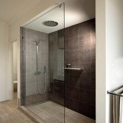 ATM Mirror and Glass - Frameless Shower Doors, Frameless Glass Enclosures - Fixed splash panel, frameless design. Optiwhite glass.