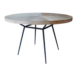 Oly Studio - Consigned Oly Studio Frank Dining Table - Designers Kate McIntyre and Brad Huntzinger formed Oly Studio to bring their vision of classic yet fresh furnishings to life. The Frank dining table features a pieced driftwood veneer top and hand-hammed black iron legs.