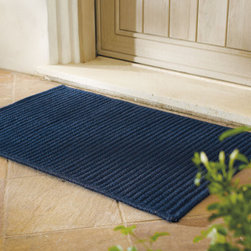 "Grandin Road - Reversible Low Profile Rug - Woven of durable all-weather polypropylene fibers. Attractive flat braid design. Simply hoses clean. Create a grand entrance with our Reversible Low Profile Rug. This rug's slim 1/4"" profile easily slips beneath the tightest openings, making it great indoors or outdoors. . . . Made in USA."