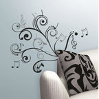 Roommates Decor - Music Scroll Notes Peel & Stick Wall Decals - This playful wall decal design combines a graphic black scroll with black and silver music notes to create a wall graphic perfect for all you musicians and music enthusiasts! Simply peel each element from the sheet and stick it to your wall or flat surface of choice. Repeat with the next piece until you've applied every sticker. Not happy with the design? Simply peel the pieces away and re-apply them as many times as you need. A great accent piece for living spaces, dorms, or near your favorite musical instrument!
