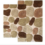 Chesapeake Merchandising - 2 Piece Pebbles Bath Rug Set - 26651 - Shop for Mats and Rugs from Hayneedle.com! Step out of the shower and onto a tufted cloud of cotton. The contemporary 2 Piece Pebbles Bath Rug Set has a non-slip backing to ensure a safe step and is available in a variety of pleasing colors to complement your decor. Set includes two matching rugs. Set Dimensions: Large rug: 24 x 40 inches Small rug: 21 x 34 inches About Chesapeake Merchandising Inc. Started in Maryland in 1995 Chesapeake Merchandising Inc. remains dedicated to producing quality textiles from the finest raw materials. Purveyors of fine rugs linens pillows and bedding they strive to stay abreast on the latest trends in the industry in order to provide their customers with the most up-to-date styles for their homes. Chesapeake employs dedicated workers with a passion for quality. Their facilities are located in both India and the United States; their permanent showroom is located in New York New York.