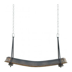 Retired Wine Barrel Swing - I'm head over heels for this retired wine barrel swing. I'd hang it at the end of a long hallway for an element of surprise.