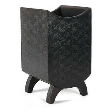 Leather Waste Bin - This may be billed as a trash bin, but it's almost too cool to hold detritus. I might fill mine with magazines instead, and store it under a side table in the living room or by the bed.