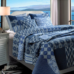 None - Santorini 5-piece Quilt Bonus Set - This charming quilt set has a sophisticated palette of blues and ivory that look great in any bedroom. The geometric shapes feature floral designs and ikat prints,and the blanket reverses to give you a coordinating design that is sure to please.