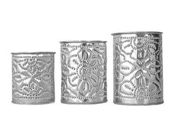 Brilliant Imports - Aluminum Candleholders, Set of 3 - These hand-crafted aluminum pieces are both beautifully sturdy and delicate, a perfect balance of qualities. We commissioned them with a shop owner in Ubud; she invited us to their workshop to watch the craftsmen hammering gently away to create these intricate patterns, a delight to behold.  These pieces will gloriously illuminate candlelight, brighten up a corner of your desk (what a pretty pencil holder!) or organize make-up or Q-tips on your vanity.  Set of 3.