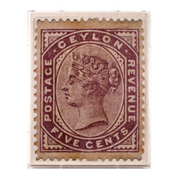 Ceylon Revenue - Framed Print - Where might a letter have gone, affixed with this plum-colored stamp from British-occupied Sri Lanka? A stunning example of the classic 19th-century postage stamp, this art print scales up the regal profile, geometric borders, and simple typography that mark the timelessness of these tiny pieces of ephemera. Warm purple monochrome makes an exotic choice of accent color in your decor.