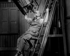 Comfortable, Astronomer David Todd with Telescope, 1924 Print - Dr. David Todd of Georgetown University, photographed Aug, 21, 1924 on 4x5 glass plate negative by the National Photo Company. More on Todd here.