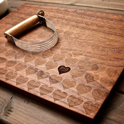 Personalized Carved Heart Engraved Wood Cutting Board by Wood Ink - Show some love! These custom cutting boards are available in multiple wood finishes and will definitely leave a smile on your face every time you use it.