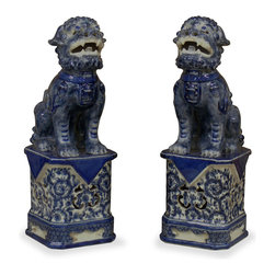 China Furniture and Arts - Blue-and-White Porcelain Foo Dogs - Originally made for royalty, blue-and-white porcelain was first exported from China in the 17th century and is still prized by collectors throughout the world. Always standing in pairs, foo dogs are fantasy lions in Chinese mythology who serve as guardians to prevent harmful things from happening to the family. This pair of blue-and-white porcelain Foo-Dogs are perfect as a symbolic Asian accent to display on a mantel or side table.