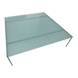 """Pre-owned Frosted Crystal Coffee Table - This beautiful square coffee table is perfect for a modern/minimalist style living room. It's Designed by Stefano Gallizioli and manufactured by Frighetto. The top is frosted glass and the legs are stainless steel.    Seller says: """"We ordered it from Italy several years ago for our Miami Beach condo. It's in excellent condition, the only minor flaw is that one corner of the glass broke off slightly, but it's only noticeable if you know it's there. We love the table but it no longer goes with our decor as we have since moved to a house and now have chosen a mid century look."""""""