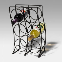 Spectrum Curve 6-Bottle Wine Rack - Black - Any wine lover will tell you that the perfect storage for your favorite bottles is almost as important as what those bottles are! The Spectrum Curve 6 Bottle Wine Rack - Black fills the bill with a cool modern look that not only enhances your table - it also keeps your wine snug and secure. Up to six bottles nestle inside the curved lines of this metal rack and are kept within easy reach at your next party... or any day. A versatile black powder coated finish stands up to daily use. This rack measures 10.5L x 6.75W x 16H inches.