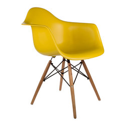 "Montmartre Arm Chair in Mustard - Some designs were ahead of their time. Considered the chair of tomorrow both for its design and its innovative single-mold manufacturing process, the Montmarte Arm Chair is inspired by one of the most iconic mid-century furniture designs. Created in the spirit of economy and affordability, its unique shape was designed to spread the sitter's weight and pressure evenly. The deep seat and waterfall edge provide additional comfort as the design shapes itself around the body's curves, while its ashwood dowel legs add a classic touch. If you've done away with formality in your home, the Montmarte Arm Chair is that one piece of furniture that exemplifies the ""less is more"" ethos. It's the ultimate seat that goes well in a variety of different settings: as a home office chair, an entryway slipper seat, or a statement piece in the living room."