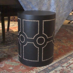 Round Leather Box/Side Table - This exotic table adds the texture of leather and nailheads to your room, and a texture that seems as though it's from a far-off place; a souk in Morocco, perhaps.