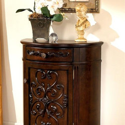 Signature Design by Ashley - Half-Moon Console Cabinet w Dark Brown Finish - A demilune Norcastle cabinet is just the right size as an entry or living room console. Elegant filigree carvings embellish the single front door panel. The top drawer is just as ornate with a center pull. Scalloping along the base adds an elegant edge. Color/Finish: Dark Brown. Dark Brown finish on select birch veneers and hardwood solids. Cast filigree under clear beveled float glass. Shapely legs and stretchers. Some assembly required. 30 in. W x 15 in. D x 36 in. H