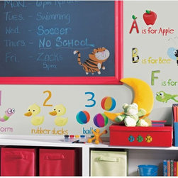 RoomMates - Education Station Peel & Stick Appliques - RMK1185SCS - Shop for Wall Decorations from Hayneedle.com! Vibrant cartoon animals and educational classics such as the alphabet number line and the bookworm mark this fun and educational set of removable wall stickers. This set is ideal for a teacher of young students but would also work great in bedrooms playrooms and for assorted items a child would want to put a sticker on. Pretty much everything come to think of it.These stickers will work on just about any surface but take care with wallpaper or some delicate surfaces. If in doubt test in an inconspicuous place prior to applying all the stickers. Also wait 10 to 15 days after painting before using stickers. Though the paint feels dry it needs adequate time to cure. As with any adhesive product these will work much better on clean surfaces free of dust and the like. Specifically they will work well on surfaces including but not limited to walls mirrors your fridge laptop covers tile glass lockers furniture and automotive surfaces.Please note this product does not ship to Pennsylvania.