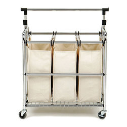 Seville 3-Bag Laundry Sorter With Hanger Bar - Keep organized with this three-bag laundry sorter. The washable, removable cotton bags hang from plastic hooks on a strong chrome frame, and large durable casters mean easy maneuvering — and they can even lock so that the cart won't roll away. Plus, the top bar can be used to hang dry cleaning or organize laundry that's delicate or prone to wrinkling.