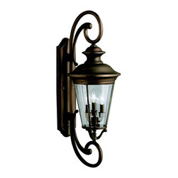 Kichler 4-Light Outdoor Fixture - Olde Bronze Exterior - Four Light Outdoor Fixture. With an air of sophistication and boldly displaying its classic lantern design, the eau Claire collection recalls a time of grace and civility. Our skilled artisans have taken high quality solid brass and produced a line of outdoor fixtures rich in detail, that returns modern lighting to simpler times. The eau Claire collection utilizes our olde bronze finish for an added antique look, while antique clear glass provides a timeless touch. This extra large 4-light wall lantern uses 60-watt bulbs, measures 13 wide by 37 high, and it is ul listed for wet location. It comes complete with variable height mounting hardware.